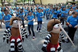 "The Philippines Department of Health performs a ""mosquito dance"" to raise awareness of vector-borne diseases. (Jay Directo via AFP/Getty Images)"