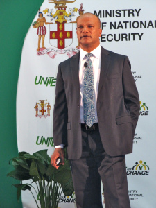 Minister Peter Bunting believes that violence is a public health problem, in Jamaica and elsewhere. (My photo)